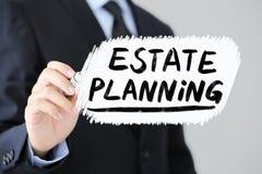 Estate Planning Business Concept. Businessman is writing Estate Planning Business Concept stock photos