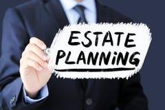 Estate Planning Business Concept. Businessman is writing Estate Planning Business Concept stock image