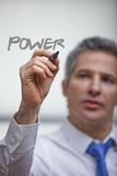 Man writing the word power Royalty Free Stock Image