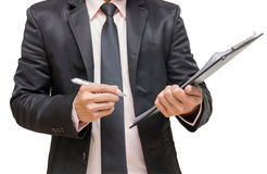 Businessman writing the file pad. On white background Royalty Free Stock Photo