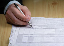 Businessman writing on a form. With pen Stock Photos