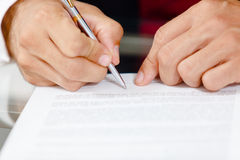 Businessman writing on a form Stock Photography