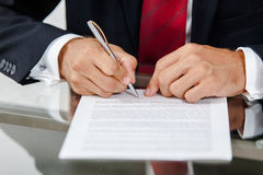 Businessman writing on a form Stock Photos