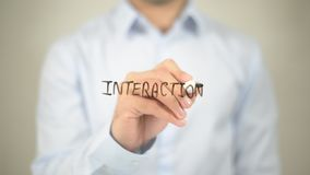Interaction, writing on transparent screen royalty free stock image