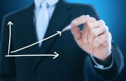 Businessman writing graph Stock Photos