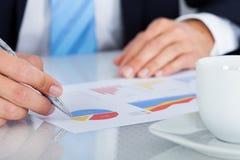 Businessman writing on graph Royalty Free Stock Photos