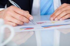 Businessman Writing On Graph Stock Photos