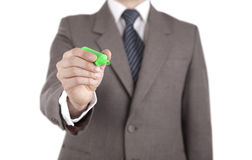 Businessman writing with green marker Stock Images