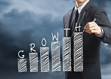 Businessman writing growth chart concept. Business man writing growth chart concept Stock Image