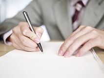 Businessman writing. Hands writing on white notebook Royalty Free Stock Photo