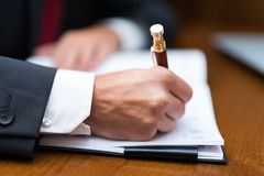 Businessman writing on his agenda Royalty Free Stock Photography