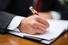 Businessman writing on his agenda Royalty Free Stock Photo
