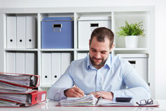 Businessman writing in his block Stock Image