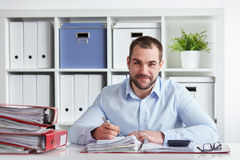 Businessman writing in his block Stock Photo