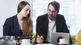 Businessman is Writing, His Colleague Has Remarks stock video footage