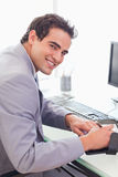 Businessman writing into his pocket calender. Young businessman writing into his pocket calender Stock Images