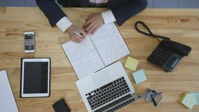 Businessman writing his to-do list, male planning day in office, top view royalty free stock photo