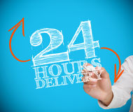 Businessman writing 24 hours delivery Stock Photography