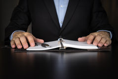 Businessman writing investment idea on book Stock Image