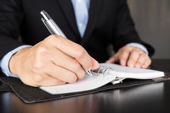 Businessman writing investment idea on book Royalty Free Stock Photos
