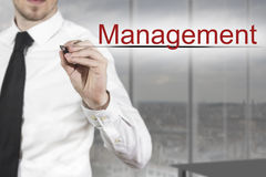 Businessman writing management in the air Stock Photography