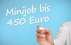Businessman writing with a marker minijob bis 450 euro Royalty Free Stock Photo