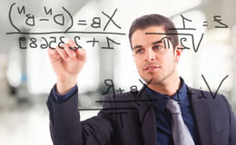 Businessman writing math Royalty Free Stock Photography