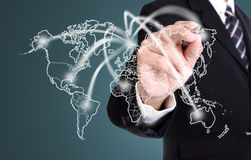 Businessman writing network line  business map. In the world Royalty Free Stock Images