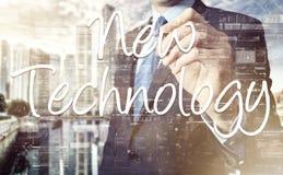 Businessman writing New Technology terminology on virtual screen Royalty Free Stock Photo