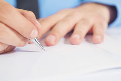 Businessman writing a note Royalty Free Stock Images