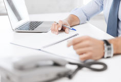 Businessman writing in notebook Stock Photography