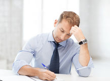 Businessman writing in notebook Royalty Free Stock Photography