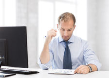 Businessman writing in notebook Royalty Free Stock Photos