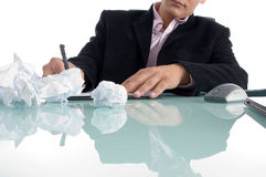 Businessman writing on notepad. On an isolated background Stock Photography