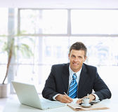 Businessman writing notes Stock Photography