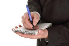 Businessman writing notes Stock Photo