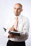 Businessman writing notes Royalty Free Stock Photo