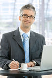 Businessman writing notes Stock Image