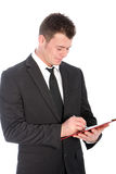 Businessman writing notes on a clipboard Royalty Free Stock Image