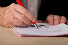 Businessman writing notes in the office Royalty Free Stock Photo