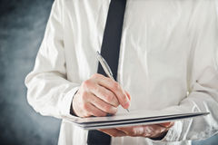Businessman writing Stock Photography