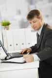 Businessman writing notes to organizer Royalty Free Stock Photos