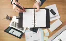 Businessman writing notes Stock Photos