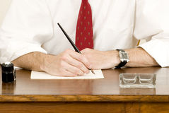 Businessman writing on a paper Royalty Free Stock Image