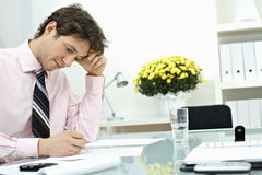 Businessman writing on paper Stock Photography