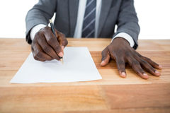 Businessman writing on a paper. Close-up of businessman writing on a paper Royalty Free Stock Images