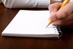 Businessman writing with pencil. Businessman writing a note with pencil Royalty Free Stock Photos