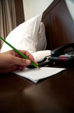 Businessman writing with pencil Royalty Free Stock Photos