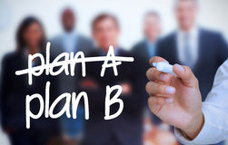 Businessman writing plan B with a marker Stock Photos
