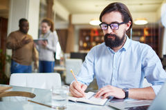 Businessman writing plan Royalty Free Stock Images